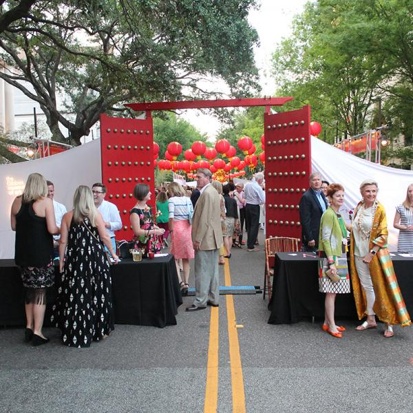 "Guests entered the seventh annual street party through  ""golden gates."""