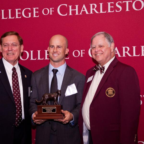 Brett Gardner (center) received the Young Alumnus of the Year award from College of Charleston president Glenn McConnell and Alumni Association president Daniel Ravenel.